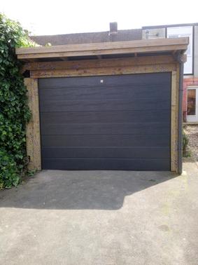 Porte sectionnelle sur Carport