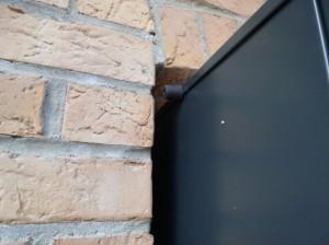 Détail d'ouverture du portillon sur porte Noviso
